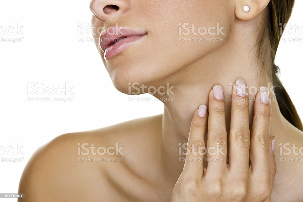 Woman gently caressing her skin stock photo