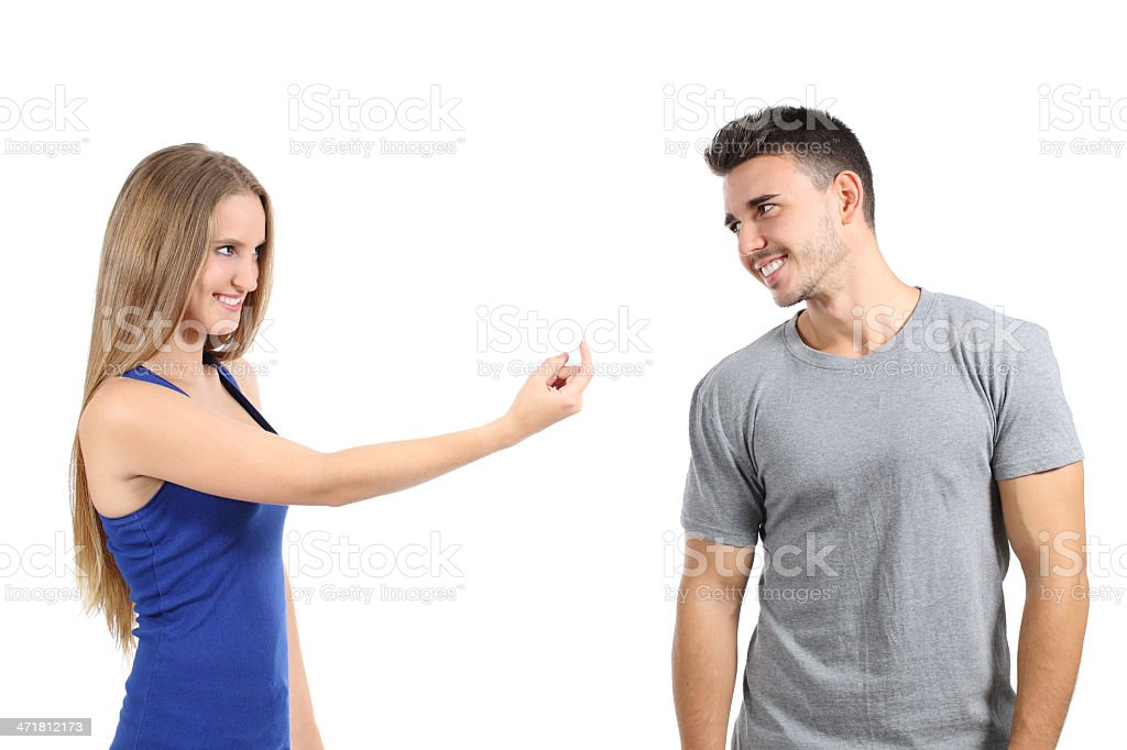 Woman gesturing beckoning to a man royalty-free stock photo