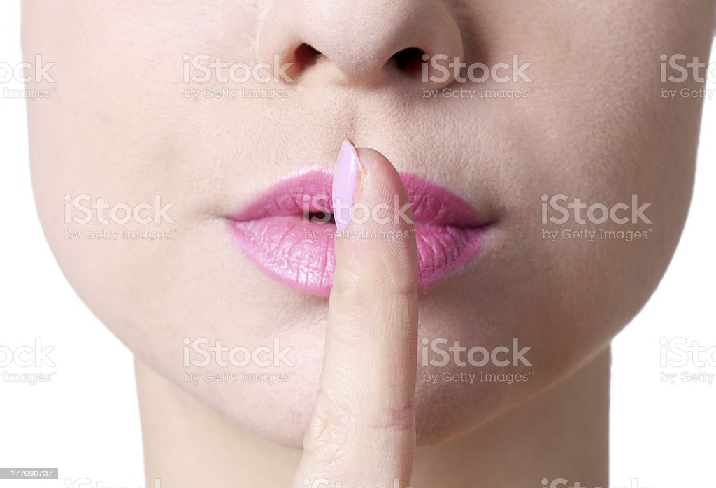 woman gesturing silence stock photo