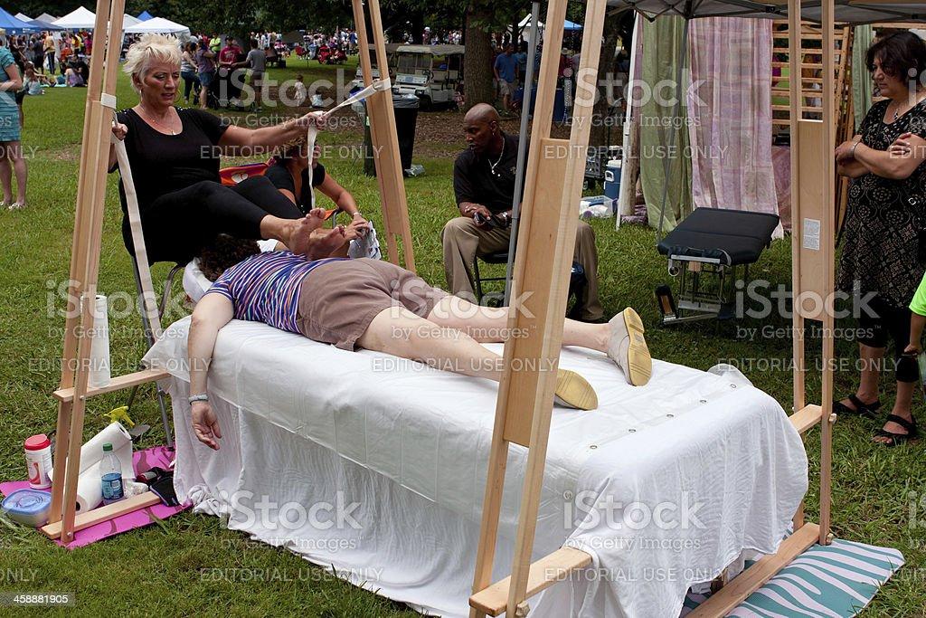 Woman Gets Ashiatsu Barefoot Massage At Summer Festival royalty-free stock photo