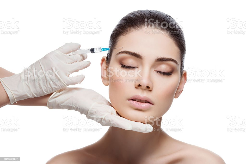 Woman gets collagen injection stock photo