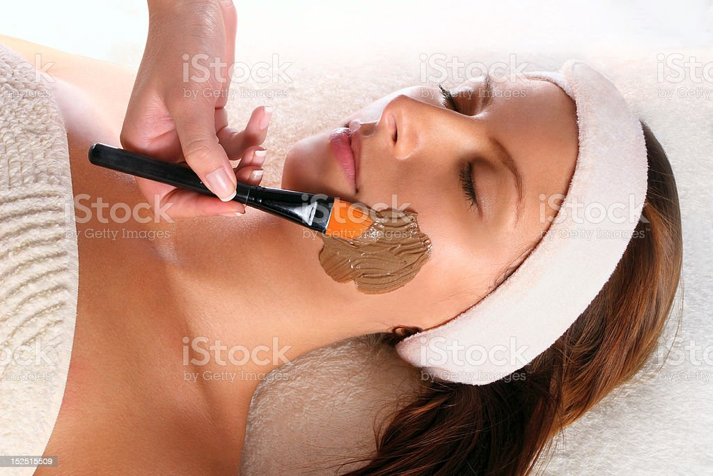 Woman getting a beauty mask treatment royalty-free stock photo