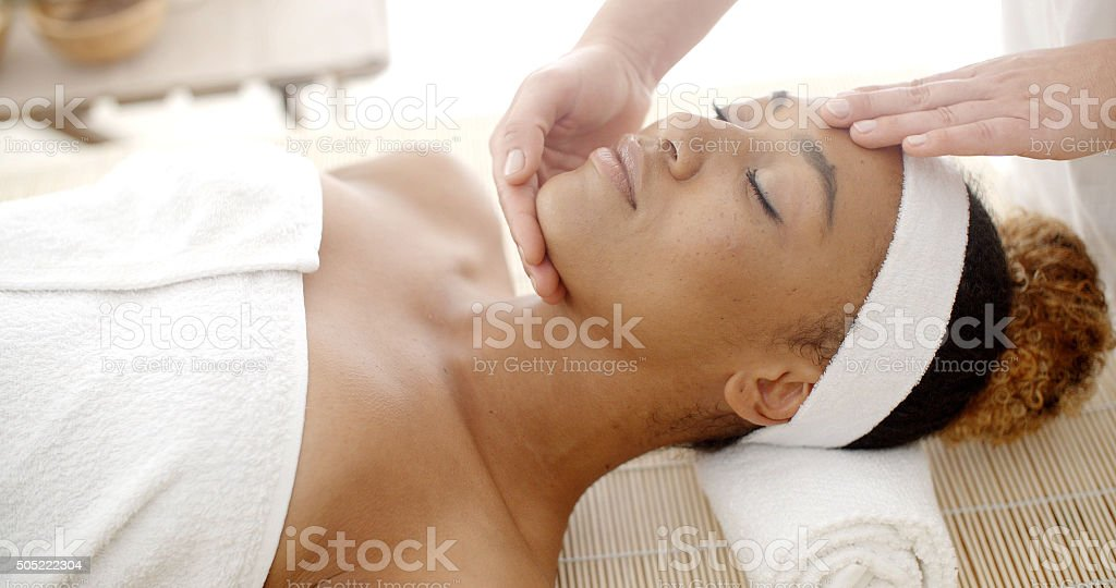 Woman Getting A Face Massage stock photo