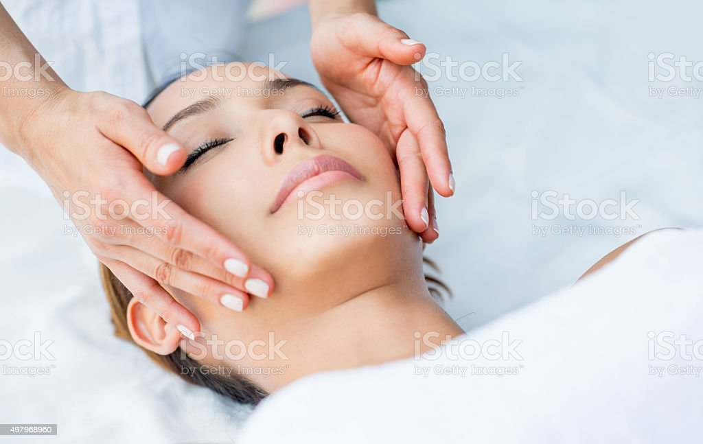 Woman getting a facial at the spa stock photo