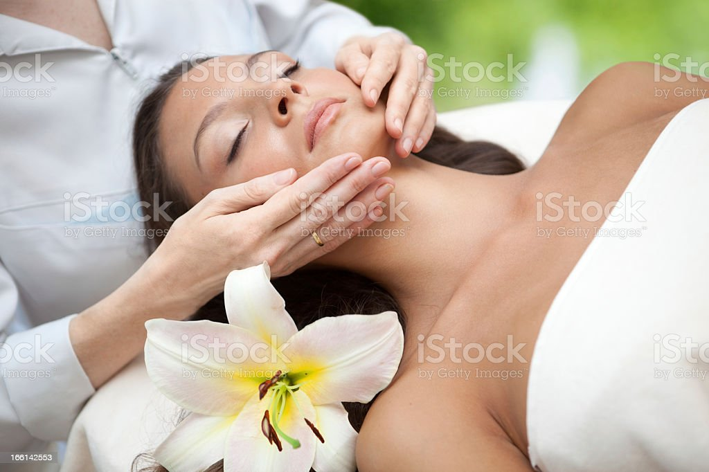 Woman getting a facial massage royalty-free stock photo