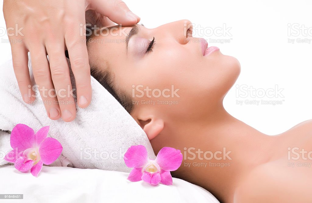 A woman getting a facial massage royalty-free stock photo