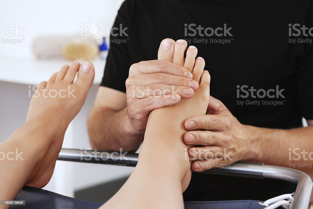 Woman Getting a Foot Massage royalty-free stock photo