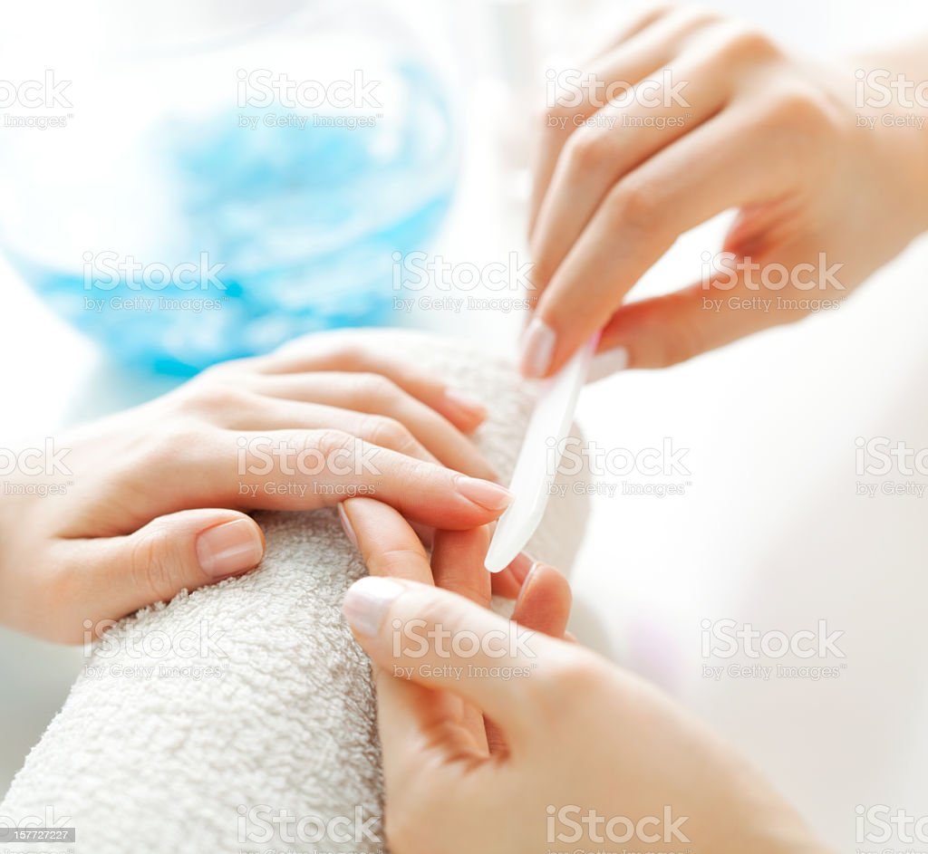 Woman getting a manicure treatment royalty-free stock photo