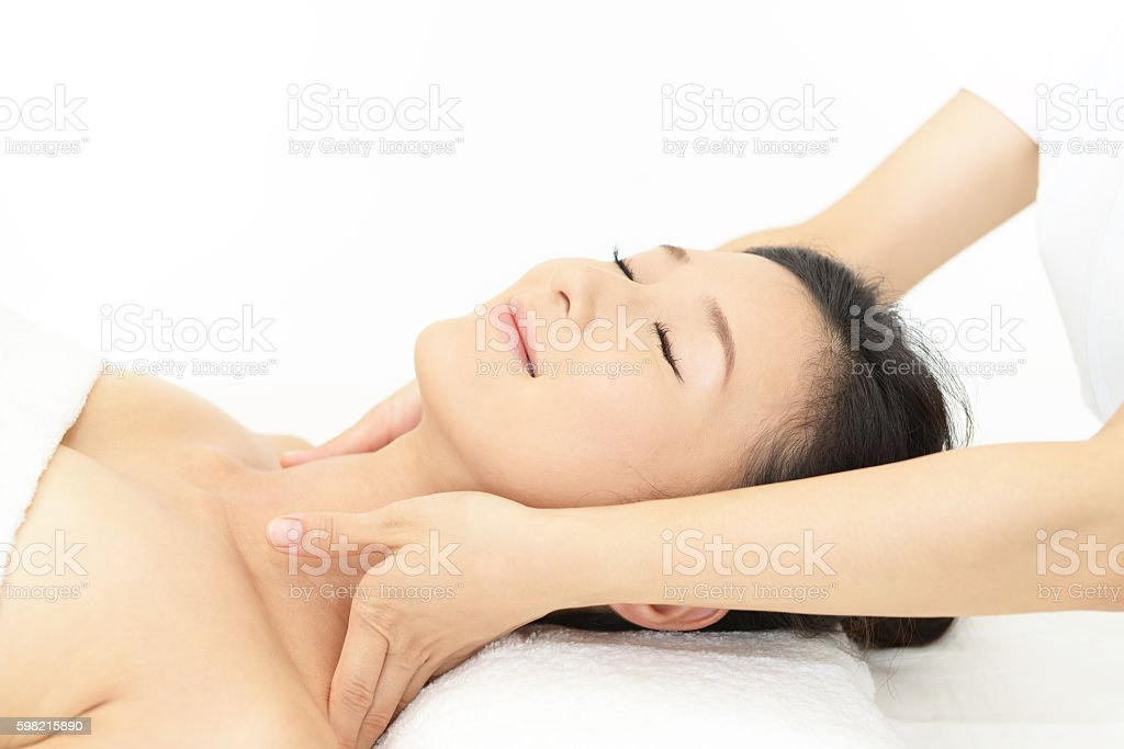 Woman getting a massage in a spa stock photo