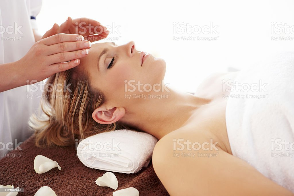 Woman Getting a Reiki treatment stock photo