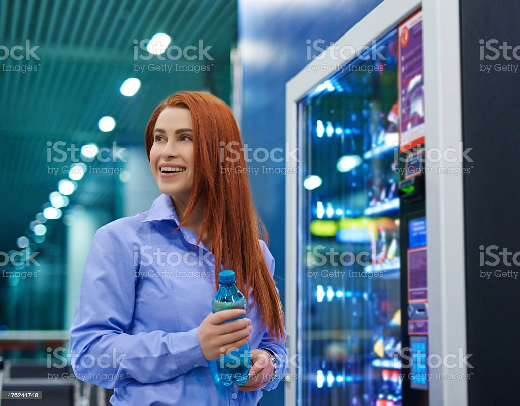 woman getting a water stock photo