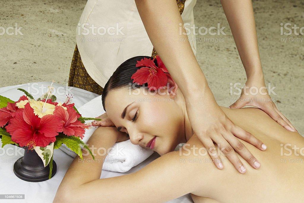 Woman getting back massage stock photo