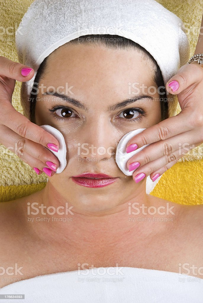 Woman getting cleasing face stock photo
