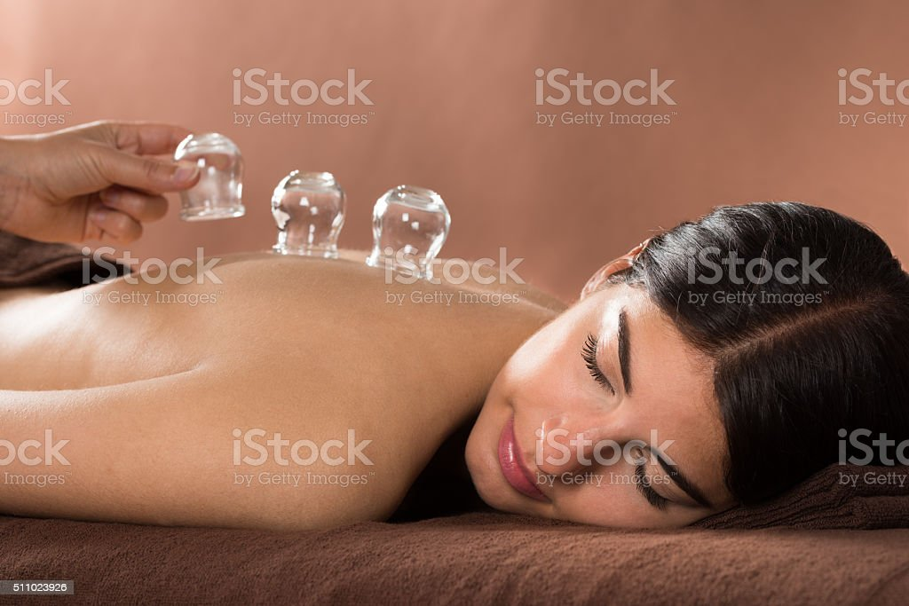 Woman Getting Cupping Treatment At Spa stock photo