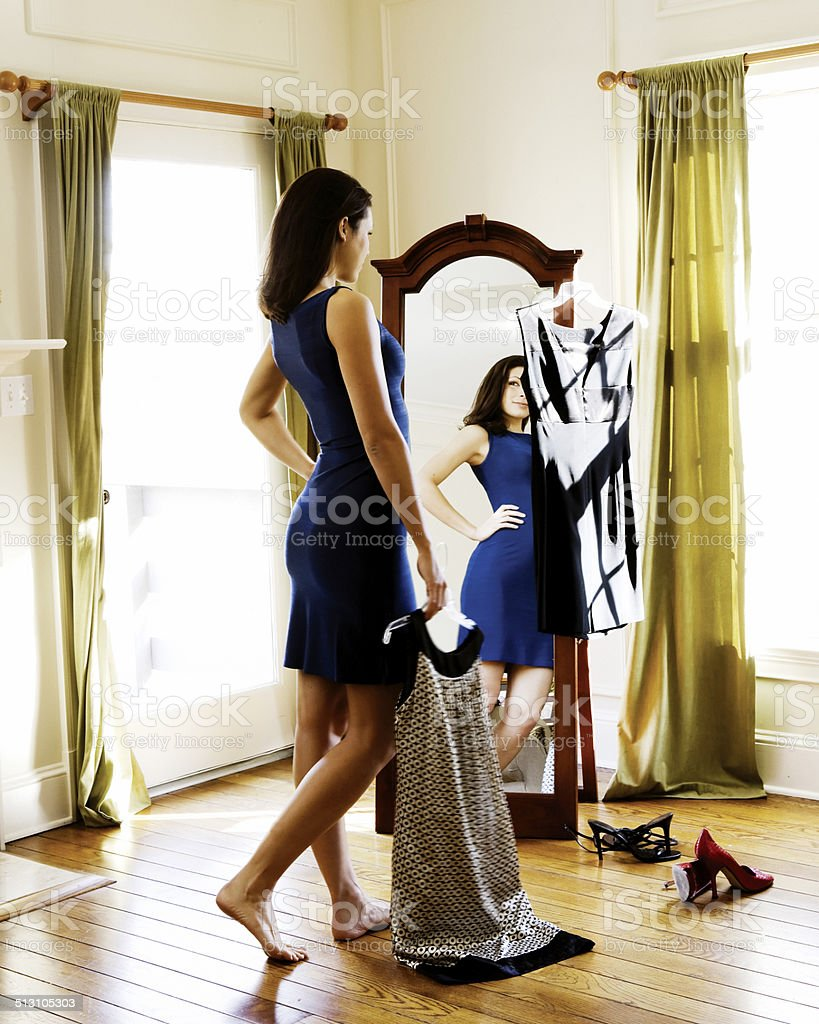 Woman Getting Dressed stock photo