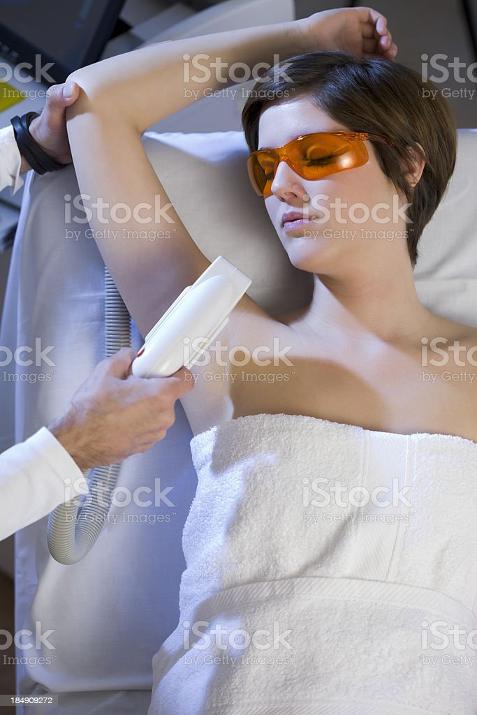 Woman Getting  Electrolysis Treatment for Under Arms royalty-free stock photo