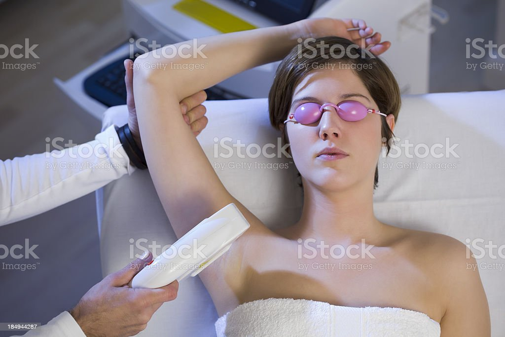 Woman Getting  Electrolysis Treatment for Under Arms stock photo
