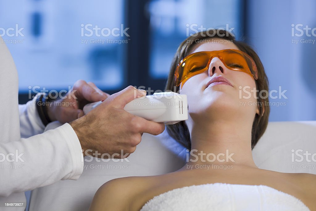 Woman getting Electrolysis Treatment on her Face stock photo