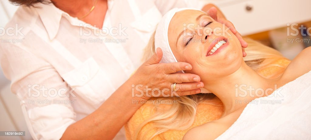 woman getting face massage royalty-free stock photo