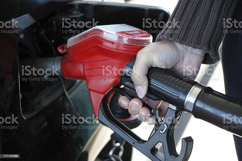 Woman Getting Gas stock photo