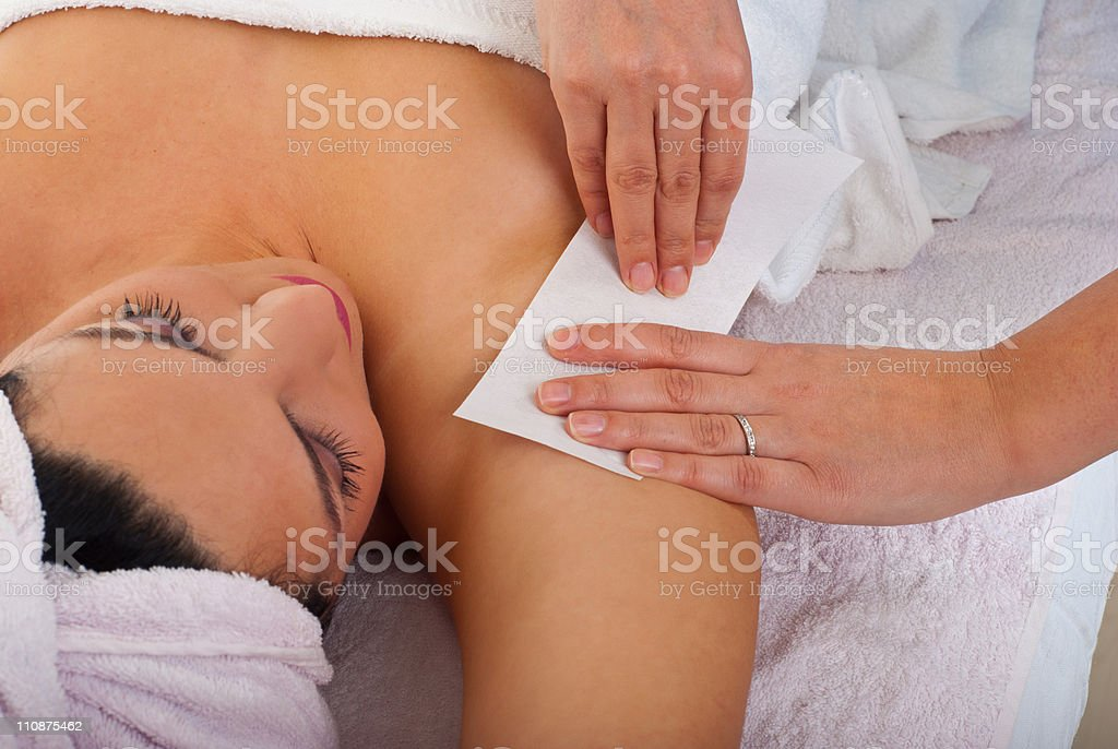 Woman getting her armpit waxed at a salon royalty-free stock photo