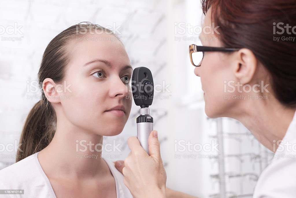 Woman getting her eye tested by an optometrist stock photo