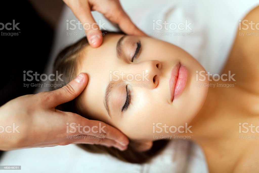Woman getting her face massaged stock photo
