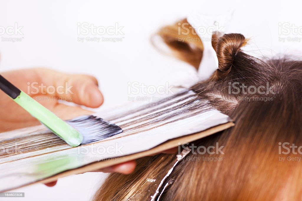 Woman getting her hair colored stock photo