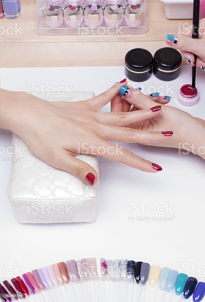 A woman getting her nails done stock photo