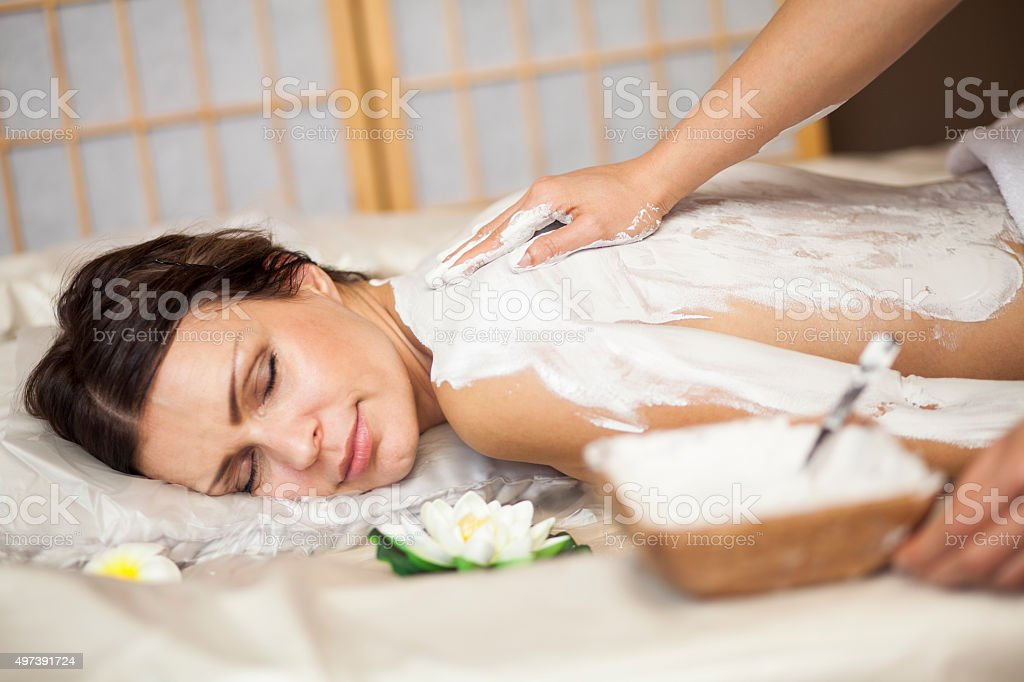 Woman getting mud treatment stock photo