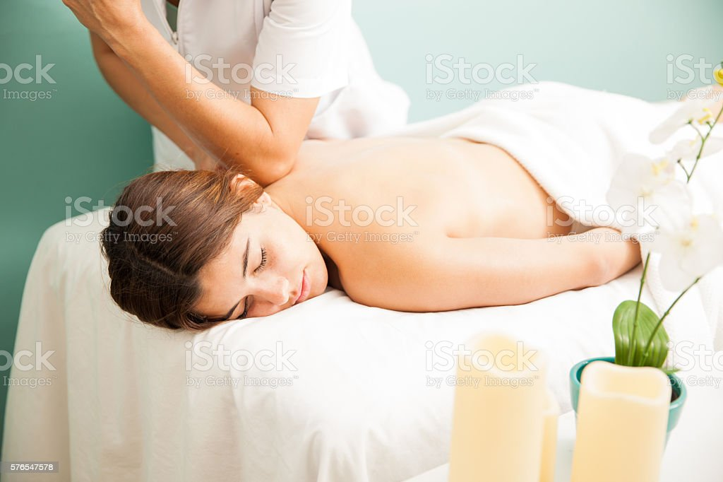Woman getting pampered at a spa stock photo