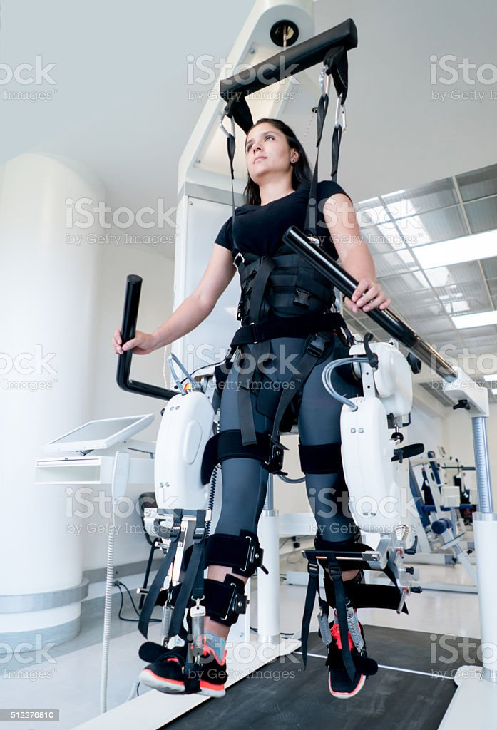 Woman getting physiotherapy on a machine stock photo