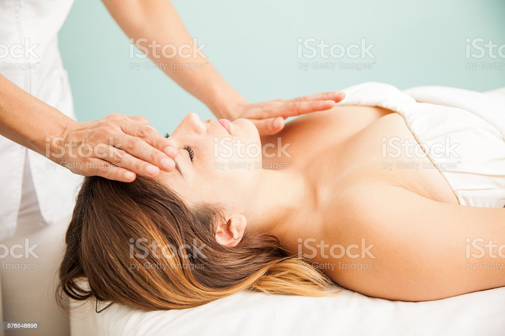 Woman getting positive energy at a spa stock photo