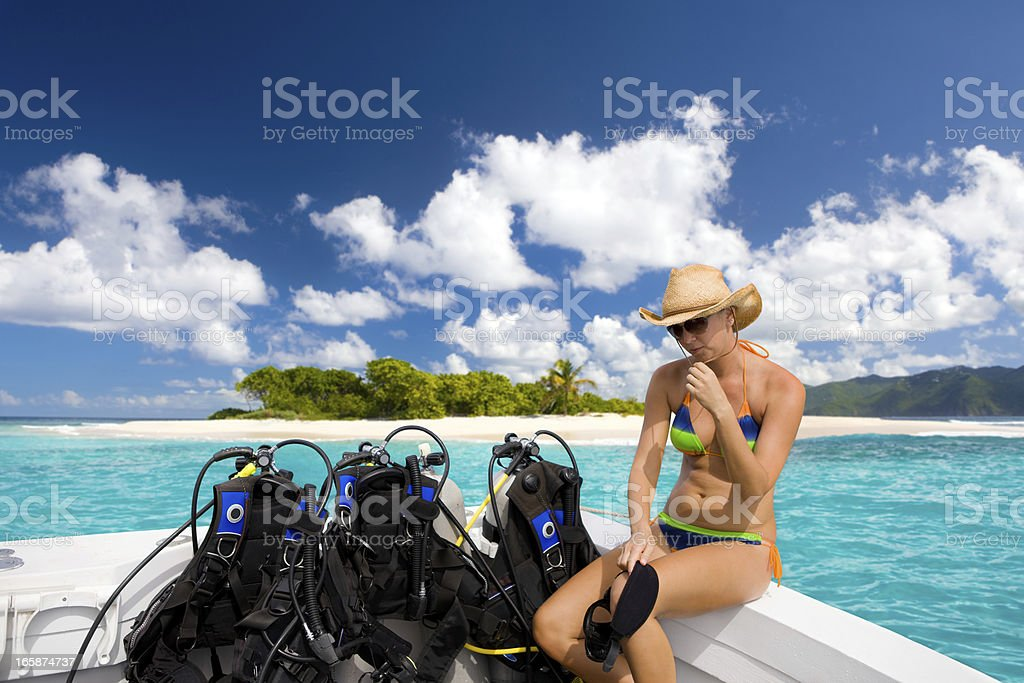 woman getting ready for a diving excursion in the Caribbean stock photo