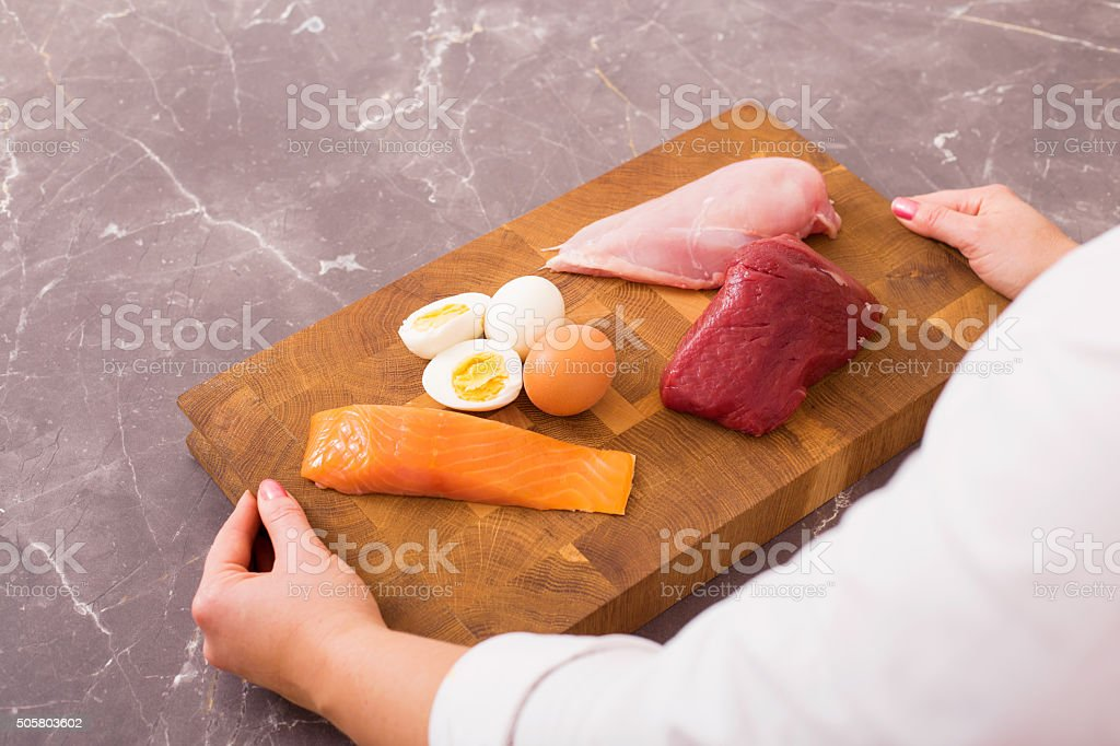Woman getting ready to prepare nutritious dinner stock photo