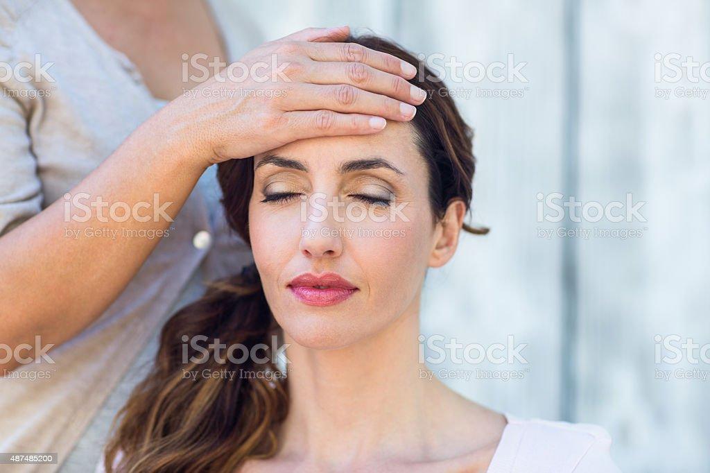Woman getting reiki therapy stock photo