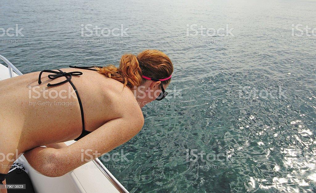 Woman getting seasick on boat stock photo