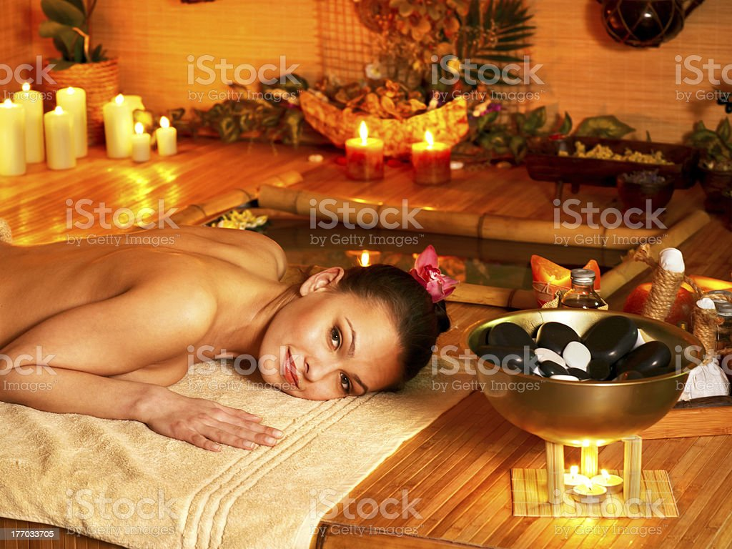 Woman getting stone therapy massage . royalty-free stock photo