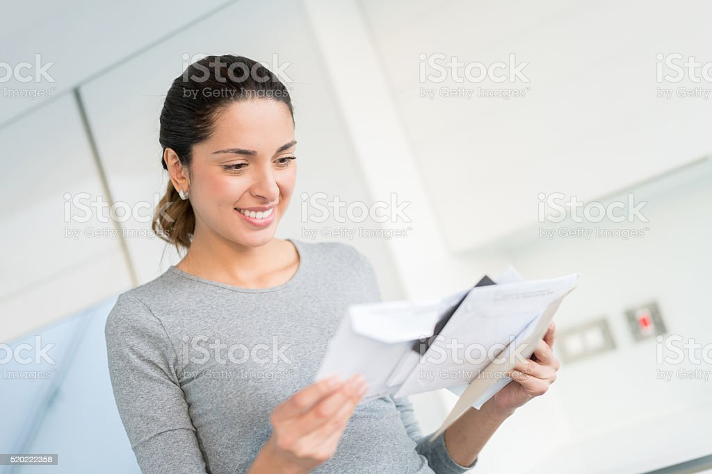 Woman getting the mail stock photo