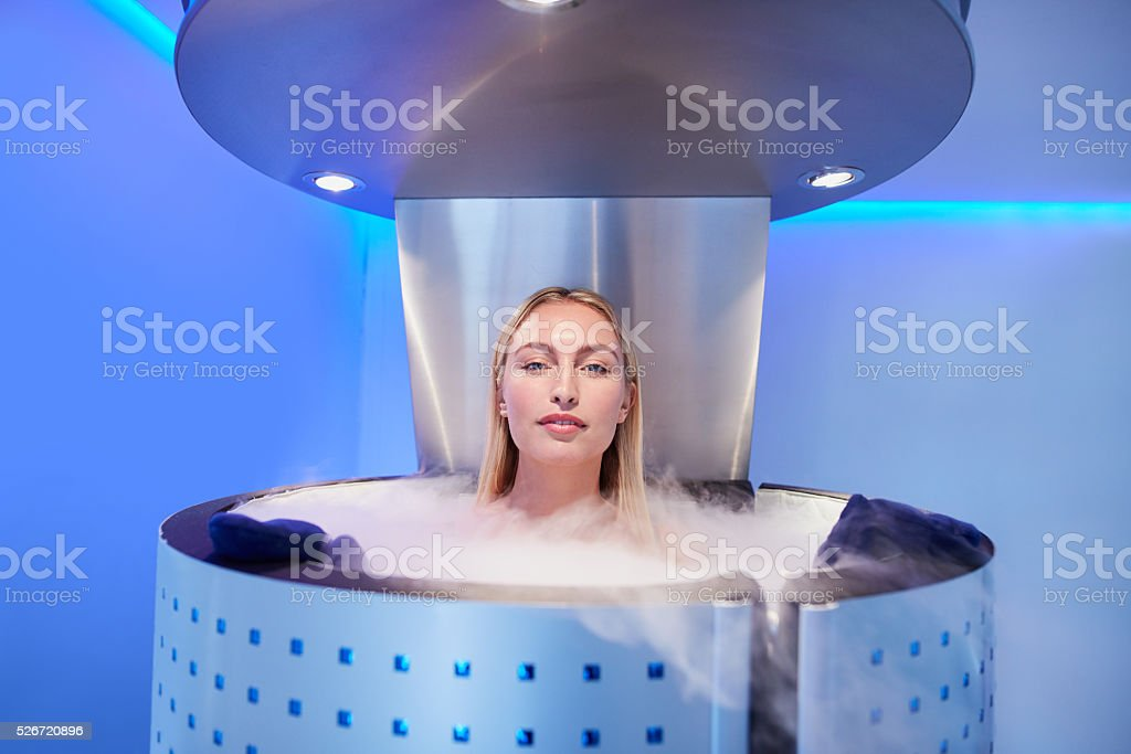 Woman getting whole body cryotherapy stock photo