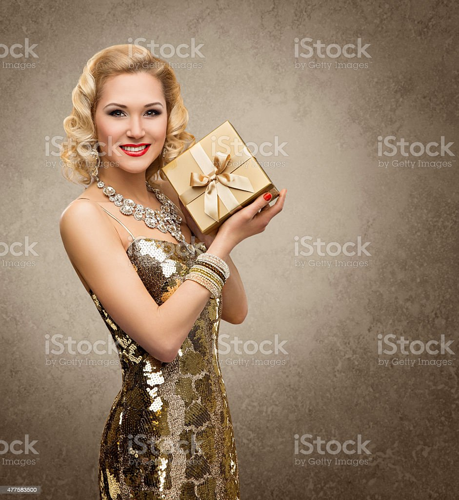 Woman Gift Box Present, Retro VIP Girl, Shining Gold Dress stock photo