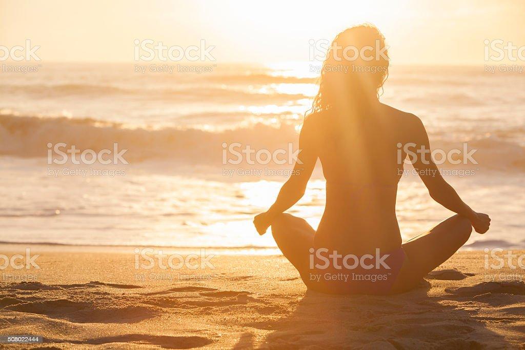 Woman Girl Sitting Sunrise Sunset Bikini Beach stock photo
