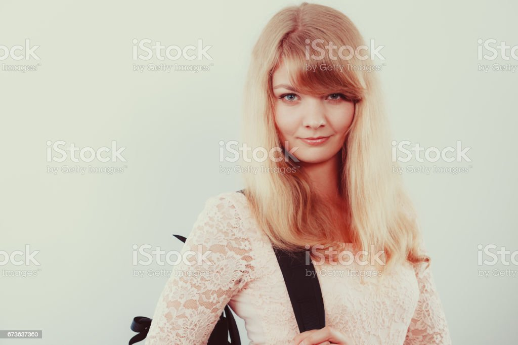 Woman girl student with backpack. stock photo