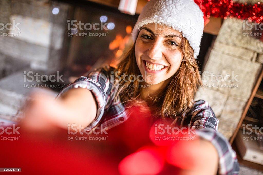 woman giving a christmas gift stock photo
