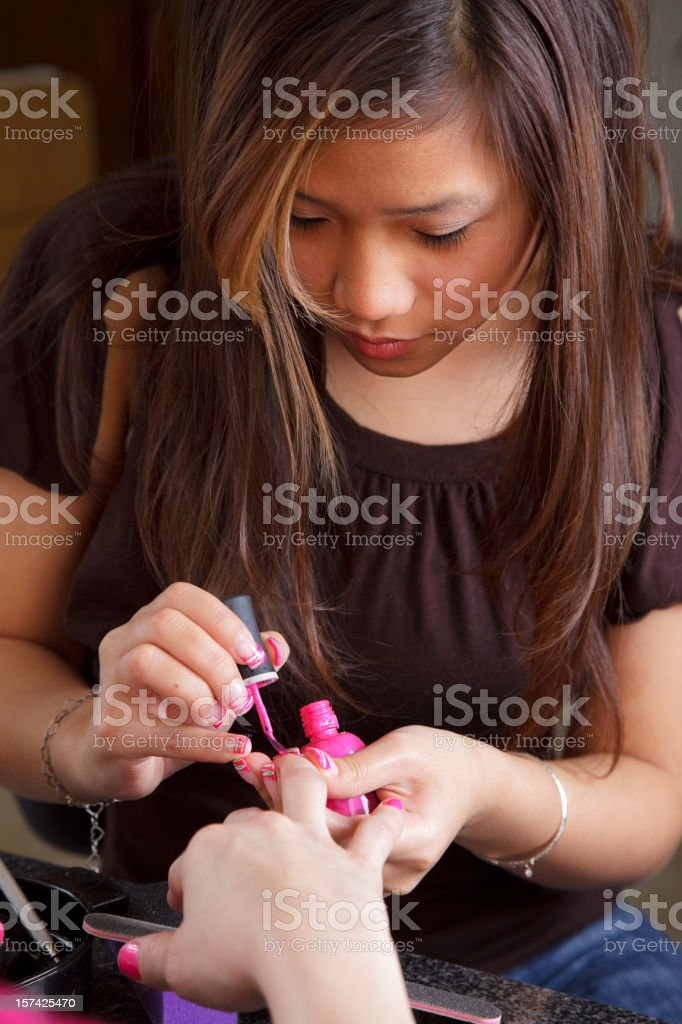Woman Giving a Manicure stock photo