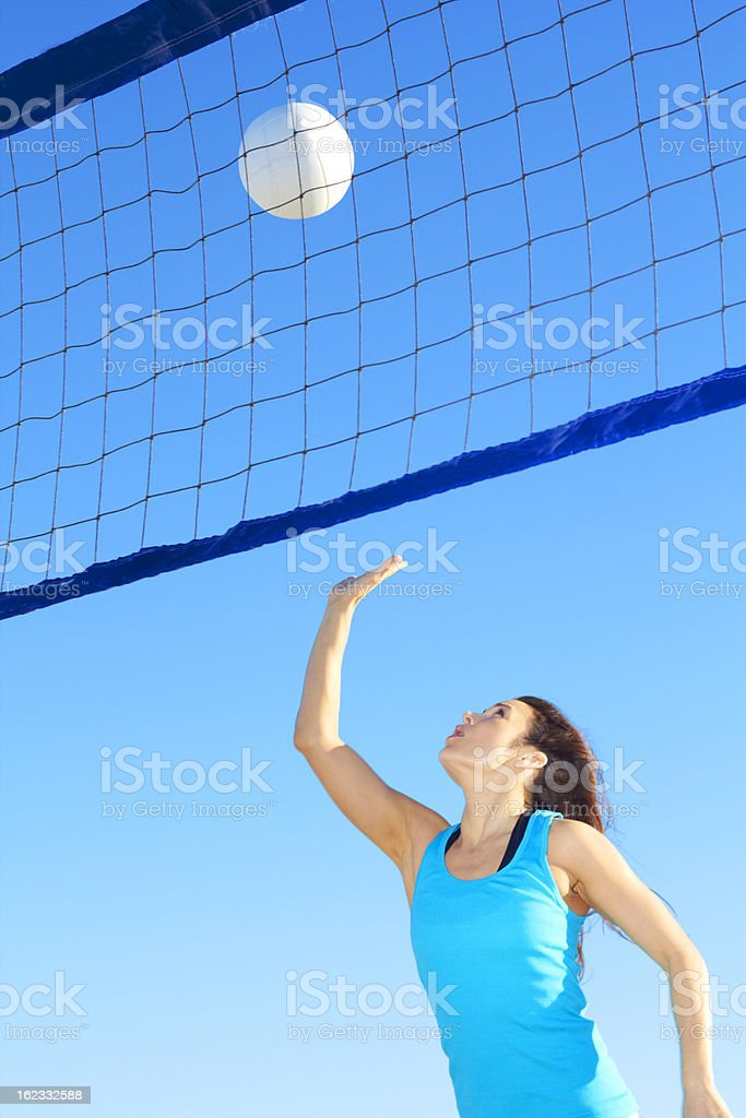 Woman Giving a Winning Hit royalty-free stock photo