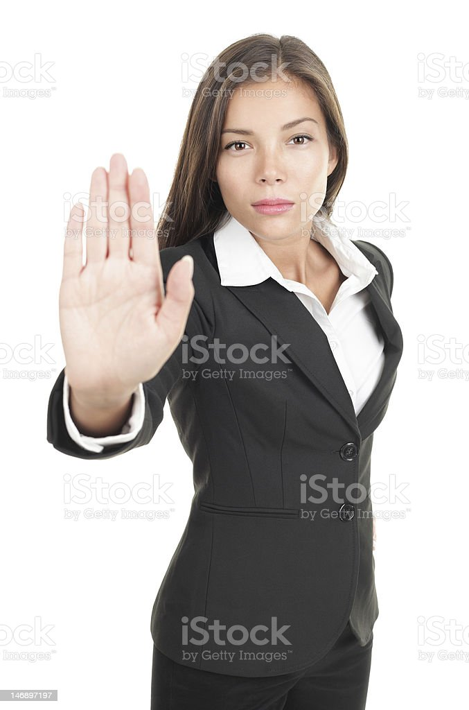 Woman giving hand stop sign stock photo