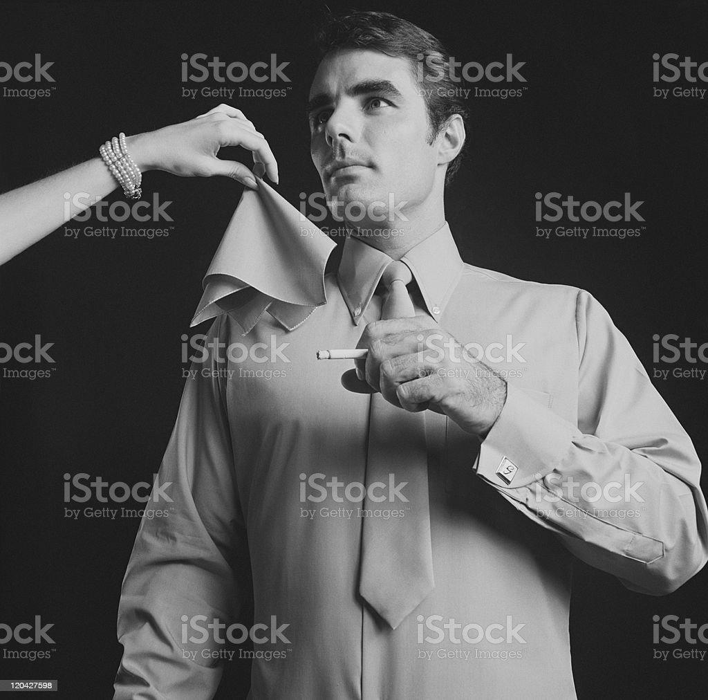 Woman giving handkerchief to smoker stock photo