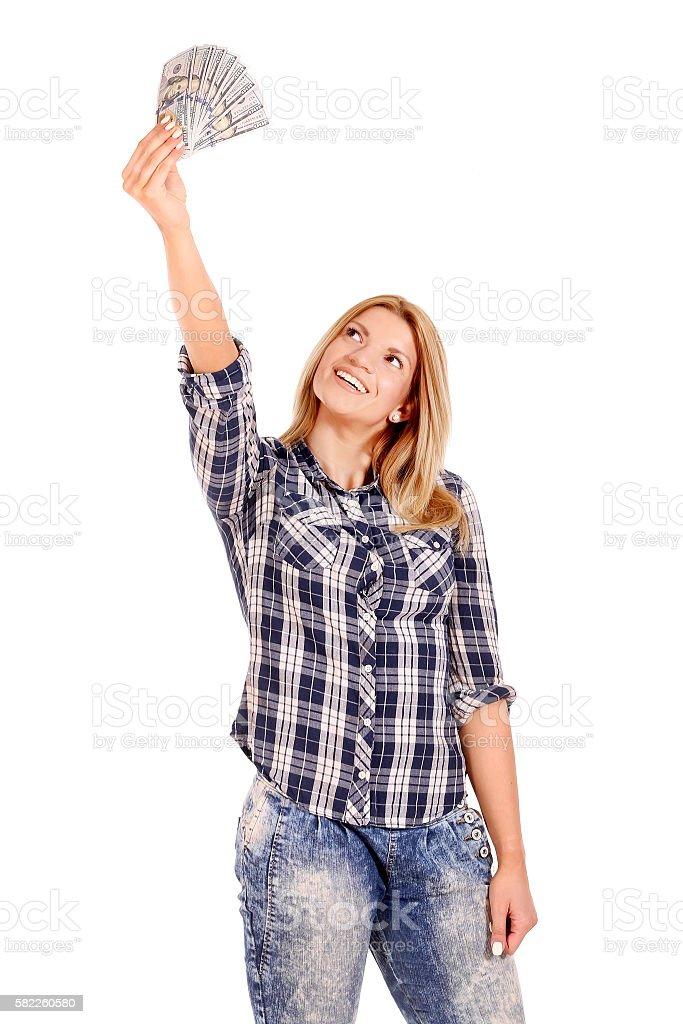 woman giving money, studio shot stock photo