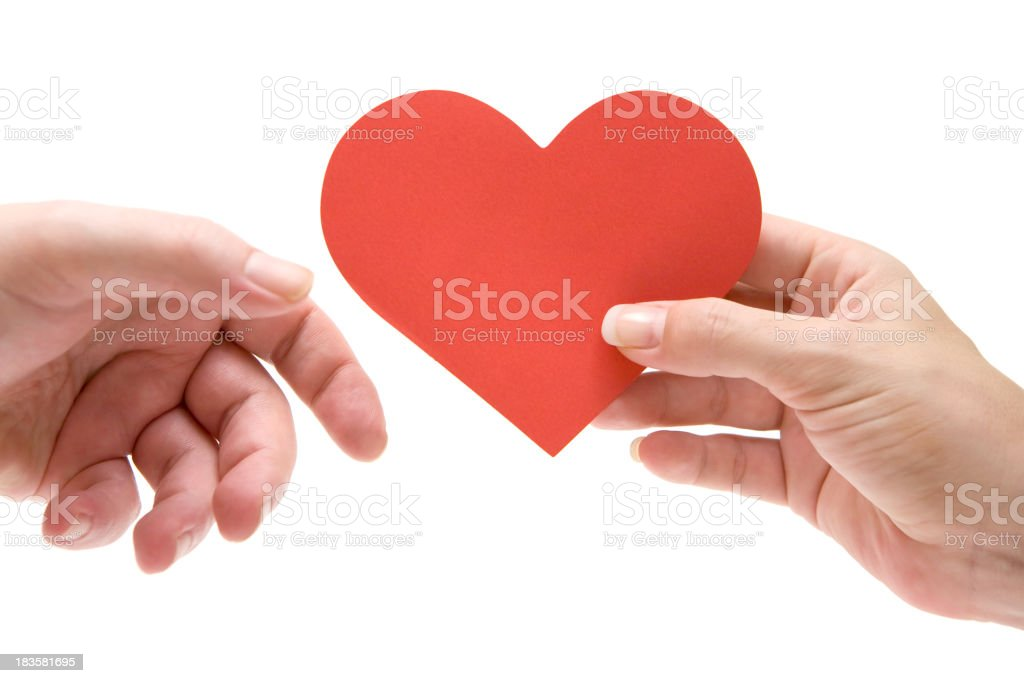 Woman giving paper heart to man stock photo
